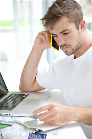 person on phone with credit card - Man Using Smartphone Holding Credit Card Stock Photo - Rights-Managed, Code: 822-07562752