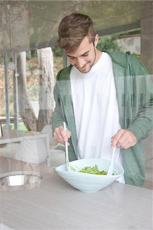 Man Tossing Salad Stock Photo - Rights-Managed, Code: 822-07562762