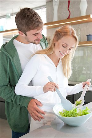 expressive - Young Couple Preparing Salad Stock Photo - Rights-Managed, Code: 822-07562763