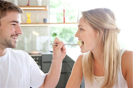 Man Feeding Woman Fruit at Breakfast Stock Photo - Rights-Managed, Code: 822-07562775
