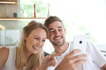 friendship - Smiling Couple Taking Selfie Stock Photo - Rights-Managed, Code: 822-07562772