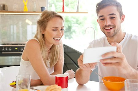 friend - Couple at Breakfast Using Smartphone Stock Photo - Rights-Managed, Code: 822-07562773