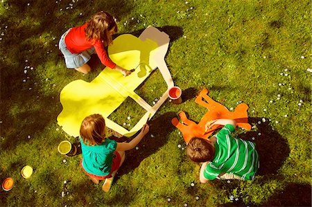 playing - Children Painting Cardboard Cut Outs in Garden Stock Photo - Rights-Managed, Code: 822-07708432