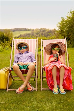 preteen boys playing - Boy and Girl Wearing Straw Hat and Sunglasses Sitting on Deck Chairs Stock Photo - Rights-Managed, Code: 822-07708445