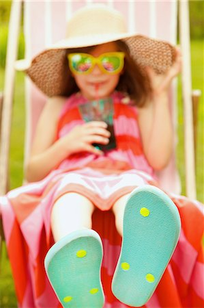 Girl on Deck Chair Wearing Flip Flops Stock Photo - Rights-Managed, Code: 822-07708448