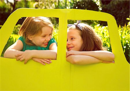Young Girls Leaning out of Cardboard Car Window Stock Photo - Rights-Managed, Code: 822-07708441