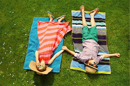 preteen boys playing - Boy and Girl Sunbathing on Lawn Stock Photo - Rights-Managed, Code: 822-07708443
