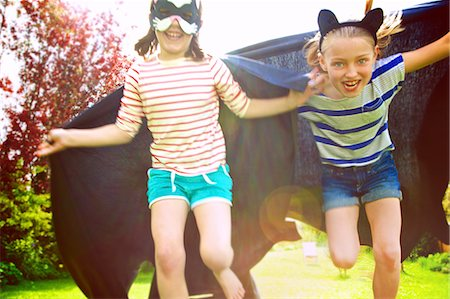 dress up girl - Young Girls Wearing Cape and Mask Running in Garden Stock Photo - Rights-Managed, Code: 822-07708456