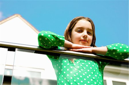 preteen girls faces photo - Young Girl Leaning on Balcony Railing Stock Photo - Rights-Managed, Code: 822-07708457