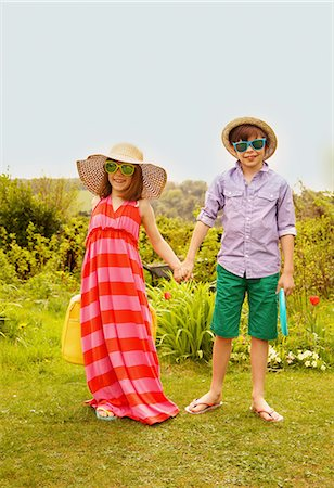 Boy and Girl Wearing Straw Hat and Sunglasses Smiling Stock Photo - Rights-Managed, Code: 822-07708450