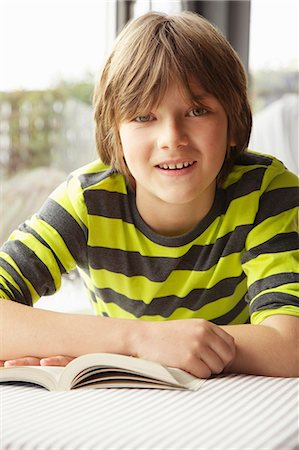 Boy Reading Book Stock Photo - Rights-Managed, Code: 822-07708453