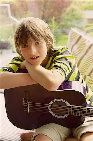 Boy Holding Guitar Stock Photo - Rights-Managed, Code: 822-07708464