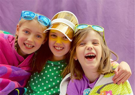 Young Girls Wearing Visor and Sunglasses Smiling Stock Photo - Rights-Managed, Code: 822-07708465