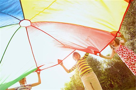 preteen boys playing - Children Playing under Parachute Stock Photo - Rights-Managed, Code: 822-07708460