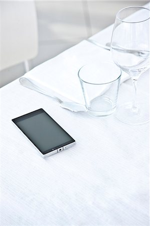 Place Setting with Smartphone Stock Photo - Rights-Managed, Code: 822-07840825