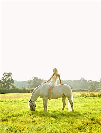 Young Woman Riding Horse in Field Stock Photo - Rights-Managed, Code: 822-07840863