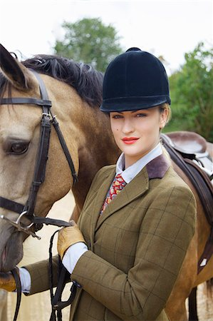 equestrian - Woman in Riding Outfit with Horse Stock Photo - Rights-Managed, Code: 822-07840876