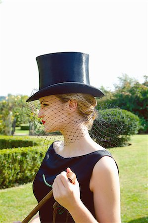 riding crop - Profile of Young Woman in Top Hat and Veil Holding Riding Crop Stock Photo - Rights-Managed, Code: 822-07840885