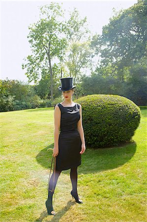 riding crop - Young Woman in Top Hat and Veil Holding Riding Crop in Garden Stock Photo - Rights-Managed, Code: 822-07840886
