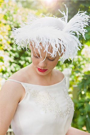 Young Woman Wearing Hat with Feathers Outdoors Stock Photo - Rights-Managed, Code: 822-07840888