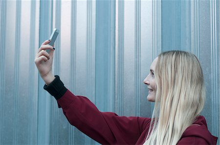 Woman Taking Selfie with Smartphone Stock Photo - Rights-Managed, Code: 822-07840890