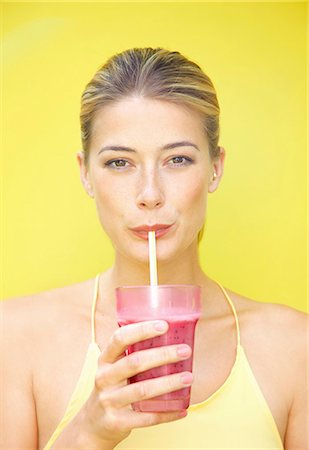 drink (non-alcohol) - Woman Drinking Smoothie with Straw Stock Photo - Rights-Managed, Code: 822-07840914
