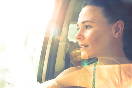 Woman Looking out of Car Window at Sunset Stock Photo - Rights-Managed, Code: 822-08026213