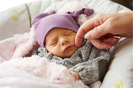 Woman's Hand Caressing Baby Girl Face Stock Photo - Rights-Managed, Code: 822-08026276