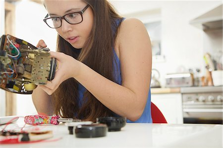 Teenage Girl Building a Telephone for Engineering School Project Stock Photo - Rights-Managed, Code: 822-08026315