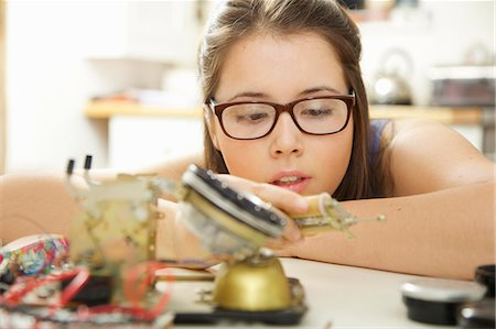 Teenage Girl Building a Telephone for Engineering School Project Stock Photo - Rights-Managed, Code: 822-08026316