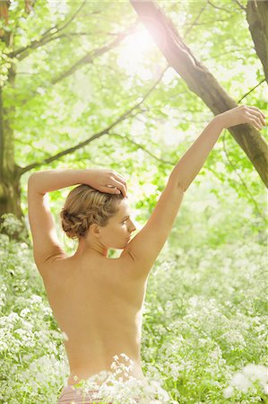 Back View of Nude Woman with Arms Raised In a Meadow Stock Photo - Rights-Managed, Code: 822-08122364