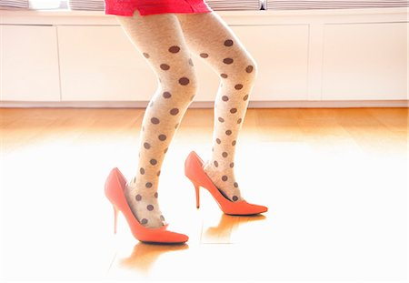 Young Girl Wearing Oversized High Heels Shoes, Low Section Stock Photo - Rights-Managed, Code: 822-08122399