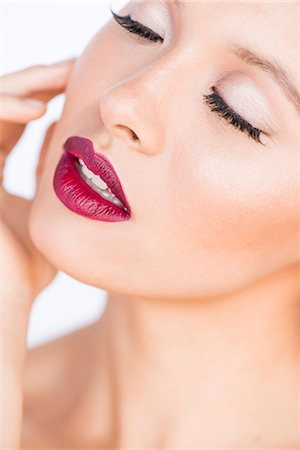 Close up of Young Woman's Face with Dark red Lips Stock Photo - Rights-Managed, Code: 822-08122439