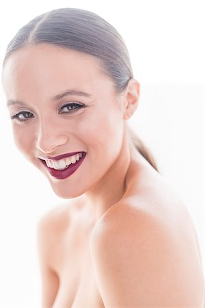 Portrait of Young Woman with Dark red Lips Smiling Stock Photo - Rights-Managed, Code: 822-08122430