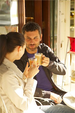 Couple at Outdoor Cafe Having Coffee Stock Photo - Rights-Managed, Code: 822-08122536