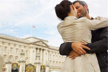 Couple Embracing Outside Buckingham Palace, London, England Stock Photo - Rights-Managed, Code: 822-08122539