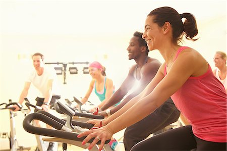 Group of People Using Exercise Bicycles at Fitness Class Stock Photo - Rights-Managed, Code: 822-08122605
