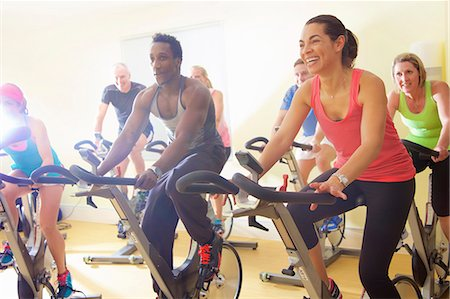 exercising - Group of People Using Exercise Bicycles at Fitness Class Stock Photo - Rights-Managed, Code: 822-08122607
