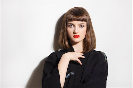 Portrait of Young Woman with Red Lips Stock Photo - Rights-Managed, Code: 822-08122641