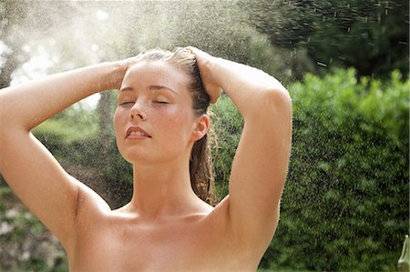 Young Woman Showering Outdoors Stock Photo - Rights-Managed, Code: 822-08353595