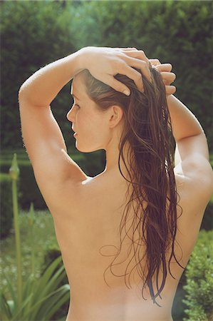 Back View of Nude Woman with Wet Hair in Garden Stock Photo - Rights-Managed, Code: 822-08353596