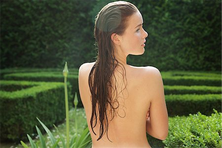 Back View of Nude Woman with Wet Hair in Garden Stock Photo - Rights-Managed, Code: 822-08353597