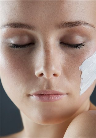personal care - Woman with Beauty Cream on Face, Close-up Stock Photo - Rights-Managed, Code: 822-08353676