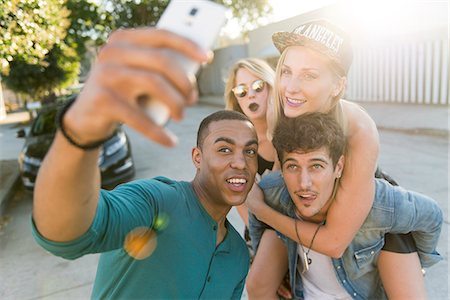 Smiling Man Taking a Group Selfie Stock Photo - Rights-Managed, Code: 822-08353758