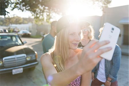 Smiling Woman Taking a Group Selfie Stock Photo - Rights-Managed, Code: 822-08353751