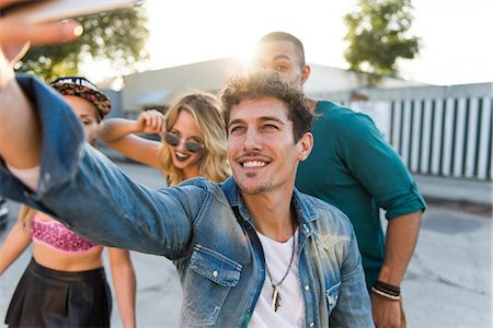 Smiling Man Taking a Group Selfie Stock Photo - Rights-Managed, Code: 822-08353761