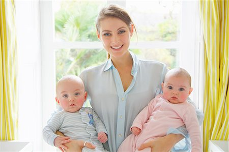 Smiling Mother Holding Twin Babies Stock Photo - Rights-Managed, Code: 822-08353831