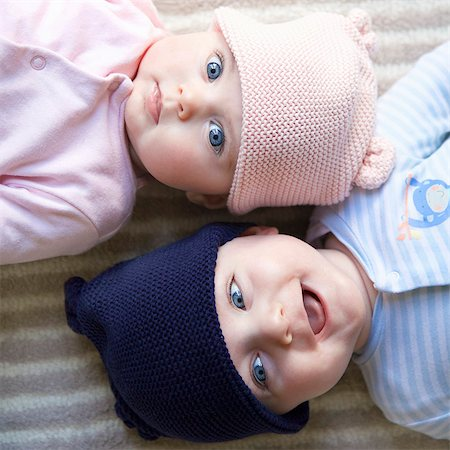 Elevated View of Twin Babies Lying on Back Facing Opposite Directions Stock Photo - Rights-Managed, Code: 822-08353852