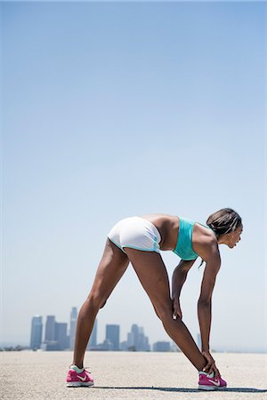 stretch - Woman Stretching, Cityscape in background Stock Photo - Rights-Managed, Code: 822-08630464