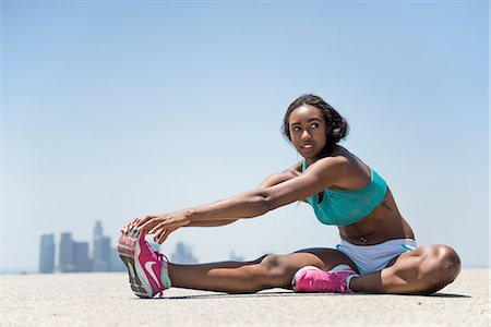 Woman Stretching Leg, Cityscape in background Stock Photo - Rights-Managed, Code: 822-08630466